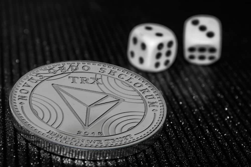 The-coin-cryptocurrency-Tron-and-rolling-dice.-Image_.jpg